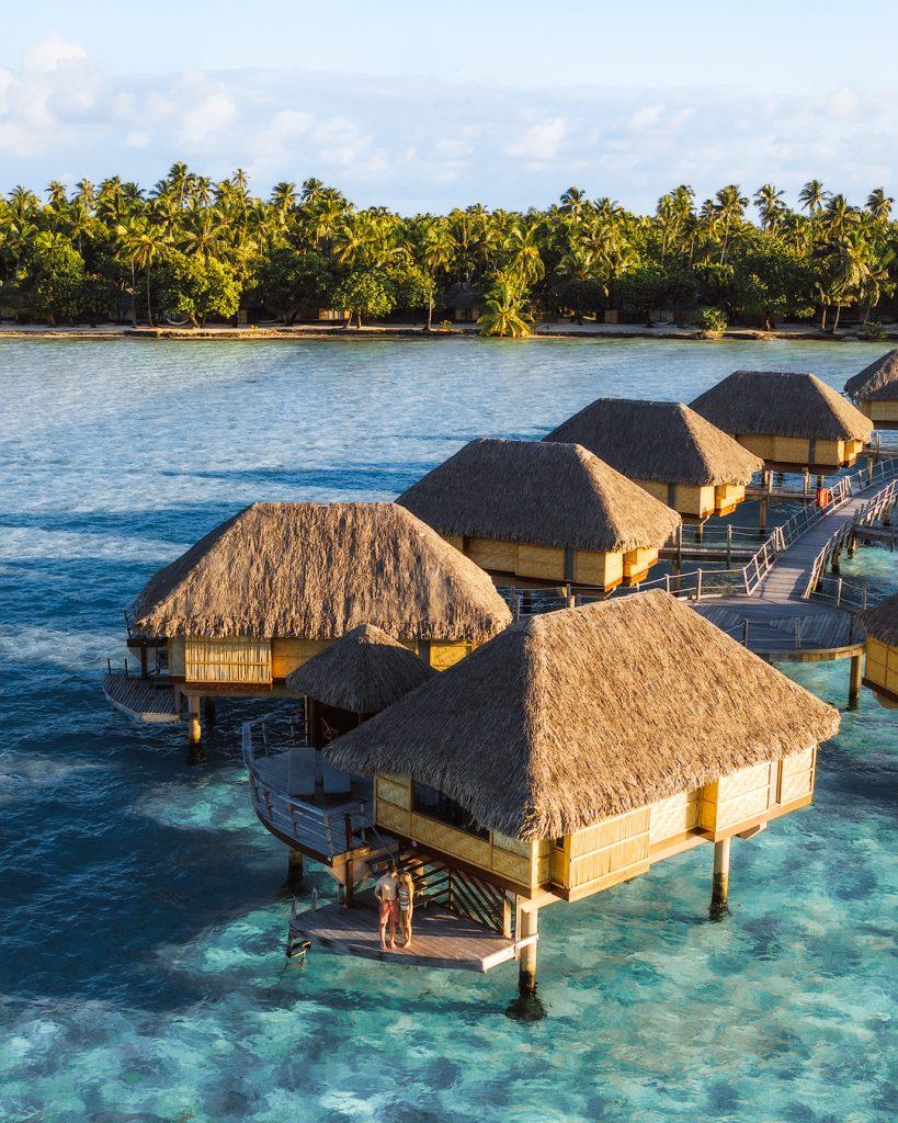 How To Take Stunning Travel Photos as a Couple - Renee Roaming - Le Tahaa Tahiti Drone