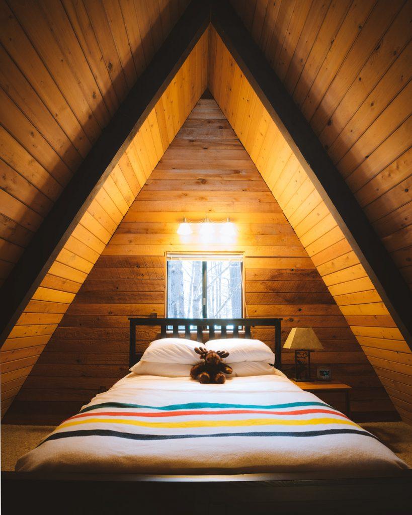 Cozy Cabins to Rent in Washington State - Foss Haus Cabin Bedroom - Renee Roaming