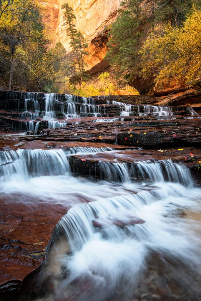12 Best National Parks To Visit In The Fall - Zion National Park Subway Hike Waterfall